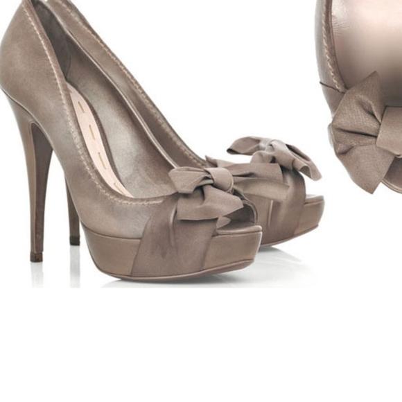 f38a7ec1b820 miu miu • brown leather bow peep toe heel. M 5a611abf05f43045c60e50d2.  Other Shoes ...